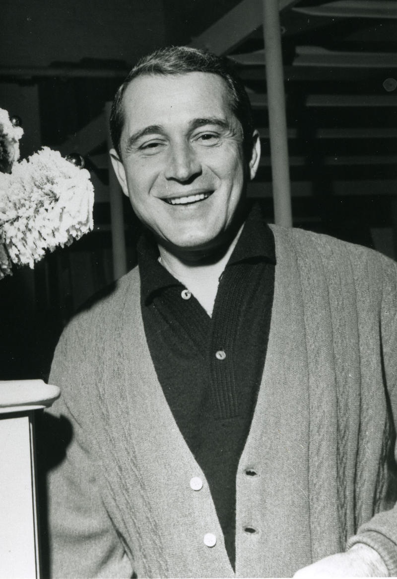 "Beloved crooner Perry Como sings ""I Wonder Who's Kissing Her Now,"" a hit from the big-band era, with the Ted Weems Orchestra."