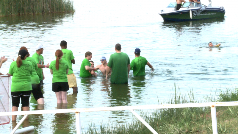 People help the swimmers has they come in.