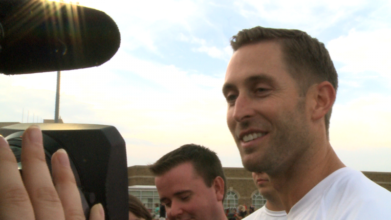 Coach Kliff Kingsbury answering questions from the media.