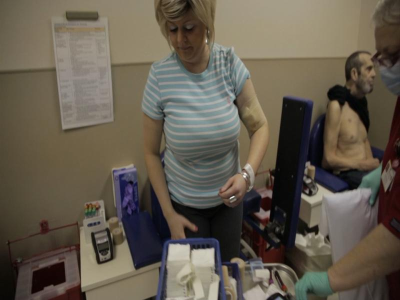 Karin Fritz has her blood taken before chemotherapy.