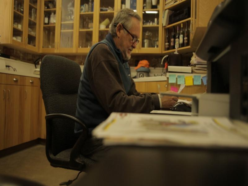 Kim McPherson works in his lab.