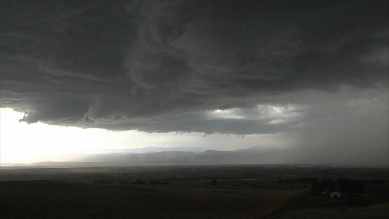 A thunderstorm forms over the plains.