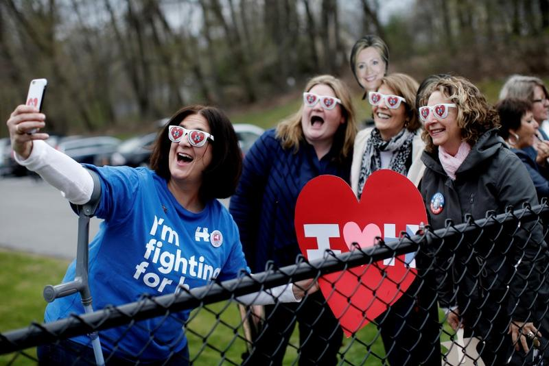 Supporters of Hillary Clinton pose for a selfie photograph outside the Grafflin School where Clinton voted in the New York U.S. presidential primary election in Chappaqua, New York, on Tuesday. Photo by Mike Segar/Reuters