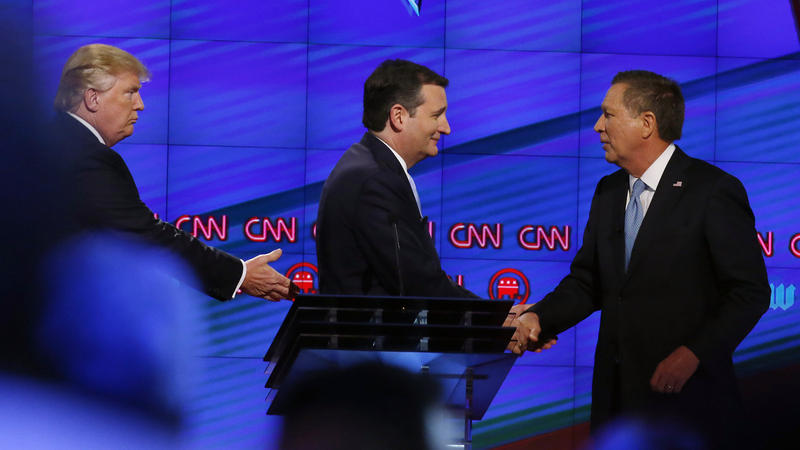 Ted Cruz (center) and John Kasich shake hands while Donald Trump looks on following the CNN Republican presidential debate last month. Rhona Wise/AFP/Getty Images