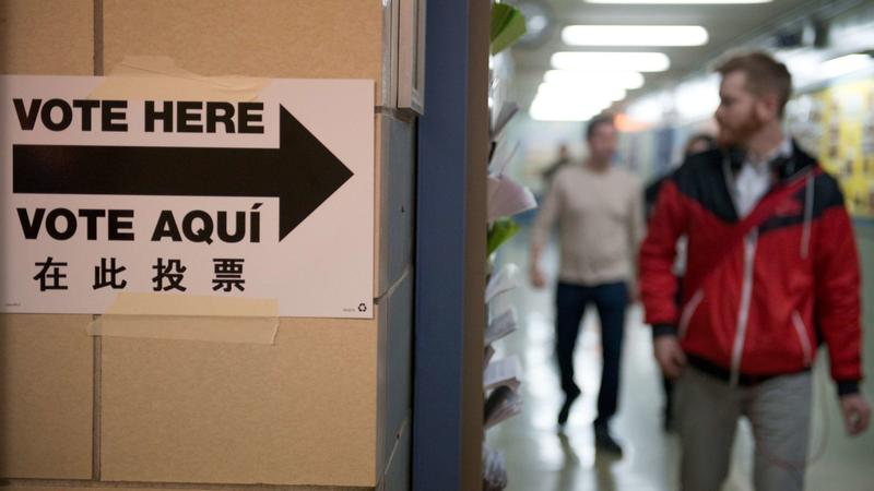 People exit the building after voting at Public School 321 in Brooklyn on Tuesday. Stephanie Keith/Getty
