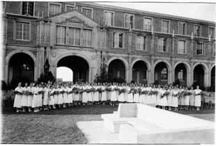 A scene from the Texas Tech Women's Recognition Day ceremony held on the south side of the Administration Building on May, 1932.