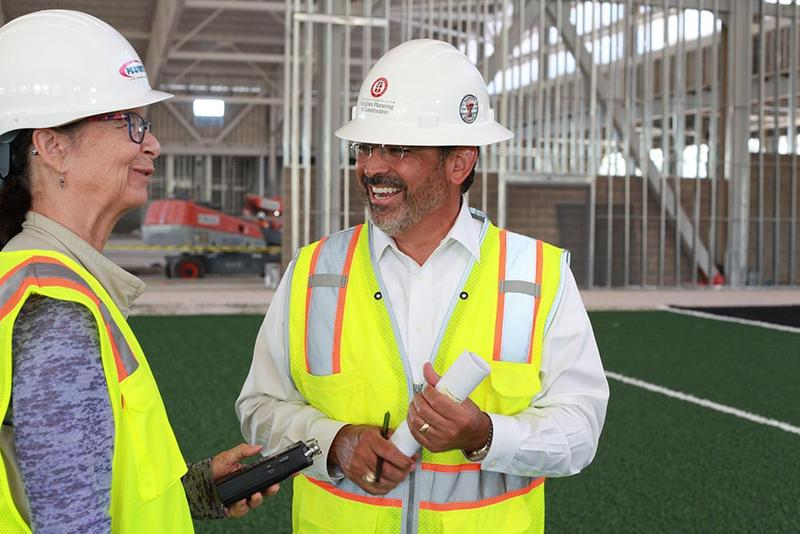 Betsy Blainey talks with Mike Molina in the midst of construction on the structure.