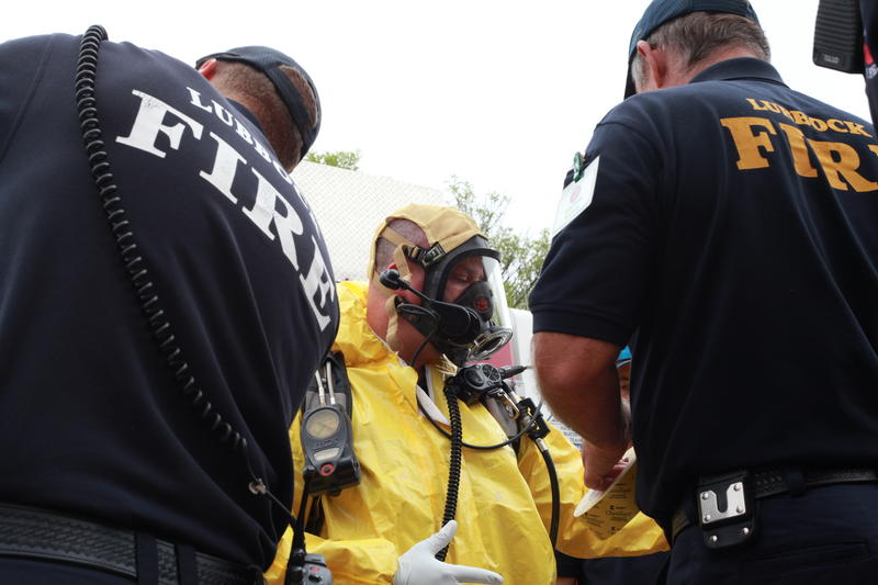 Firemen gear up to enter the site of contamination.