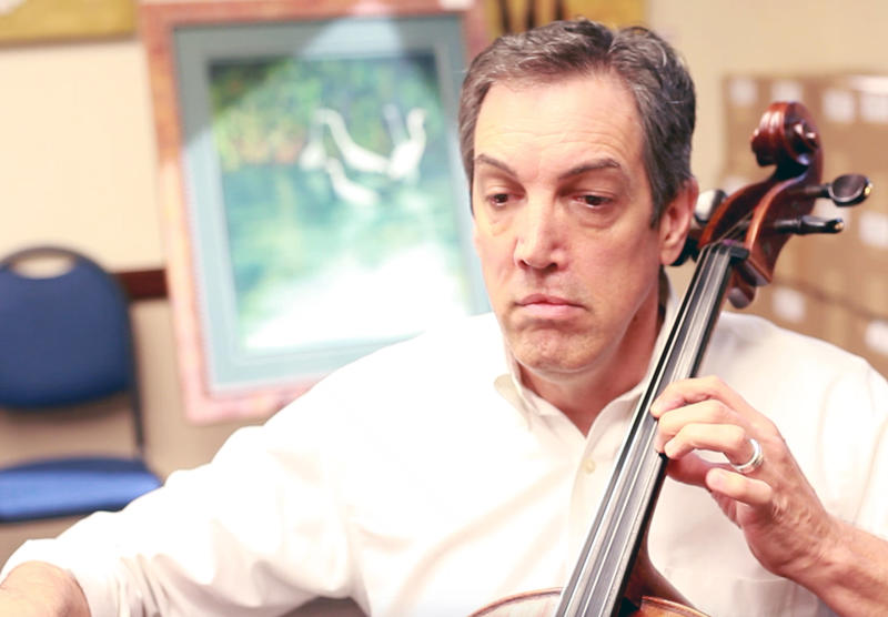 Galen Wixson playing the cello.
