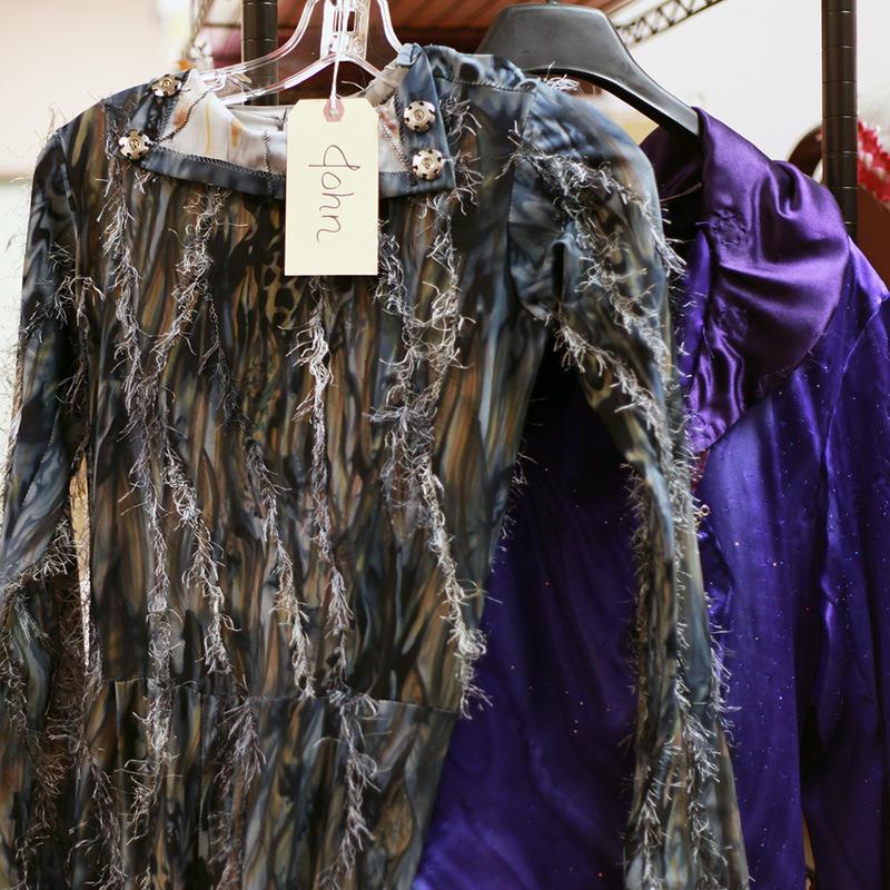 Costumes hang in the props room of Ballet Lubbock.