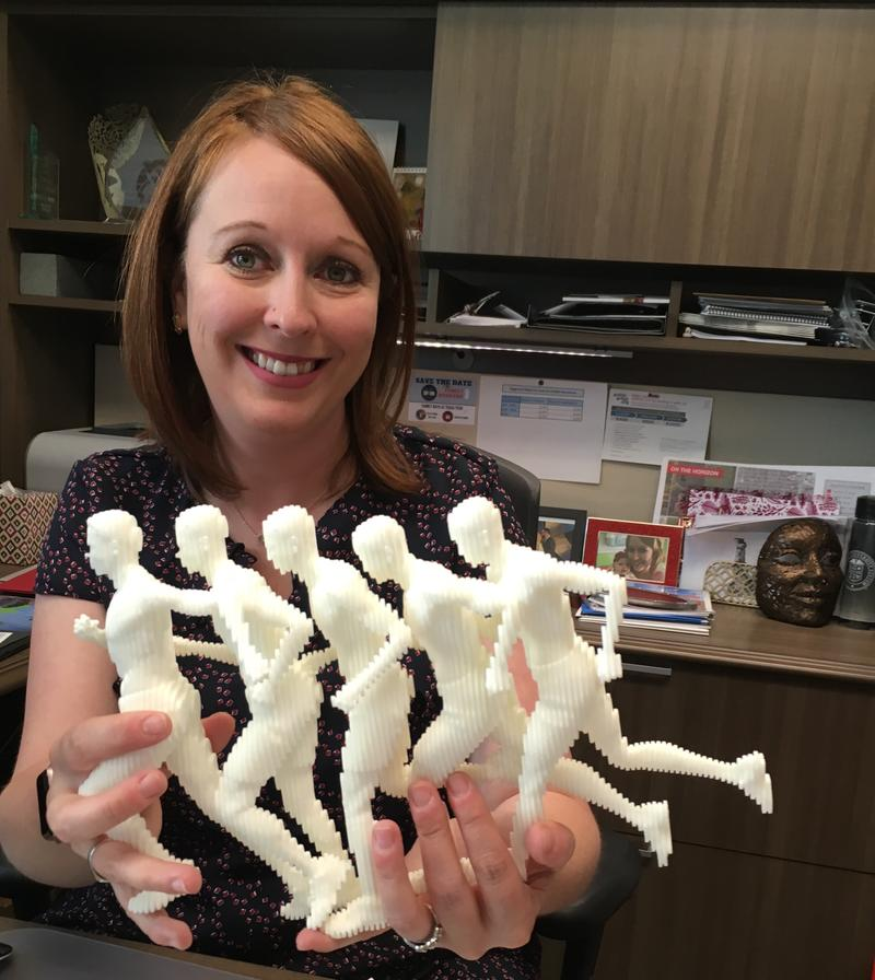 "Emily Wilkinson holds an early model of one of Texas Tech's most recent public art installations, ""Run."""