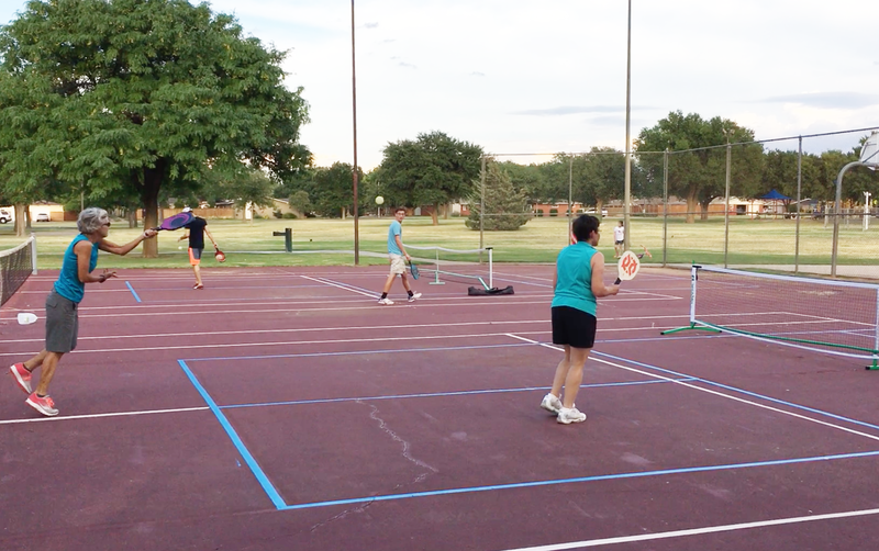 Lubbock residents gather for a game of Pickleball.