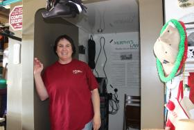 Karen Stark stands in her newly installed safe room in her garage in Norman.