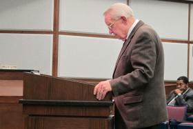 Harold Heiple, chairman of Norman's charter review committee, addresses the city council in Norman June 17.