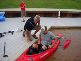 Ray Utter gets into a special kayak on the Oklahoma River