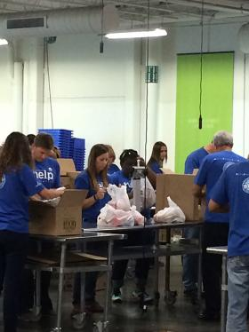 Regional Food Bank volunteers fill food sacks for distribution in one of its children's feeding programs.