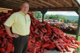 Oklahoma Scenic Rivers Commission Executive Director Ed Fite next to a mountain of life vests at the War Eagle Resort near Tahlequah, Okla.