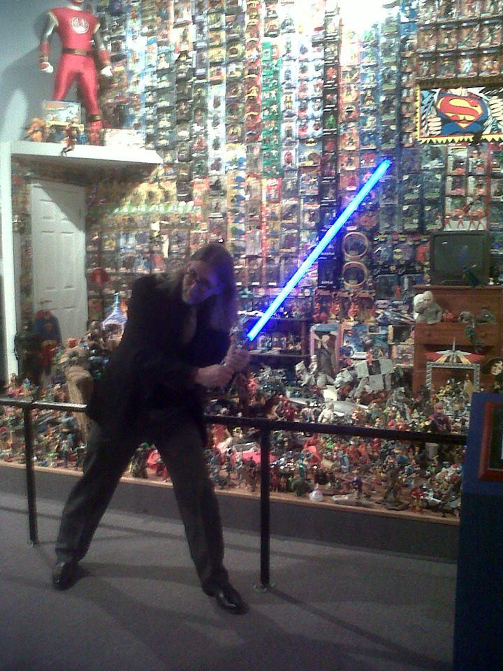 Toy designer and Toy and Action Figure Museum Curator Kevin Stark shows off his light saber skills.