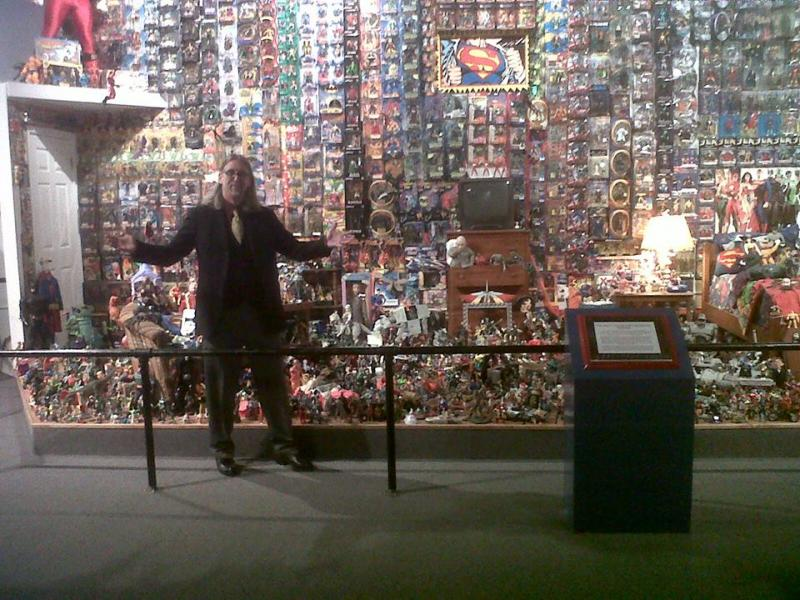 "Toy designer and Toy and Action Figure Museum Curator Kevin Stark in front of the ""centerpiece"" of the museum, the bedroom diorama he built himself."