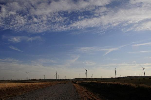 Wind turbines line the horizon near Kingfisher, Okla.