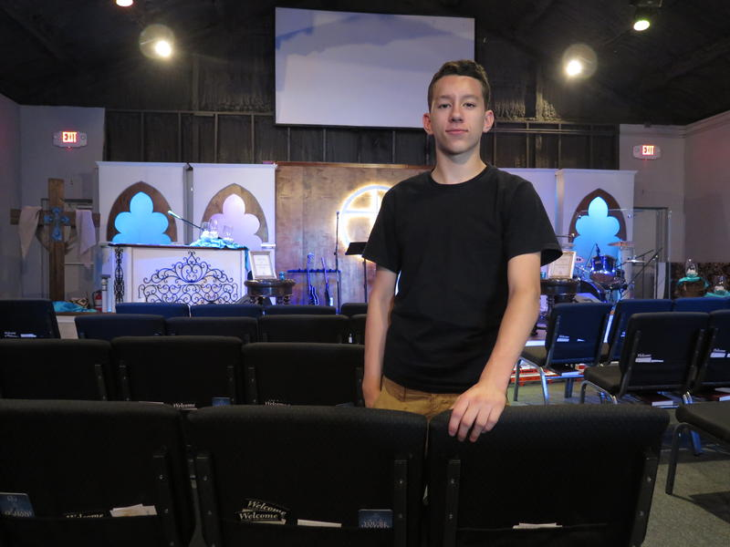 Xavier Espinoza, 14, poses at the church where he volunteers his time. Espinoza and his mother were homeless for many years, but have had a stable home for the past two.