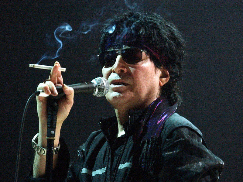 Singer Alan Vega, seen here onstage in France in 2004, died Saturday at age 78.