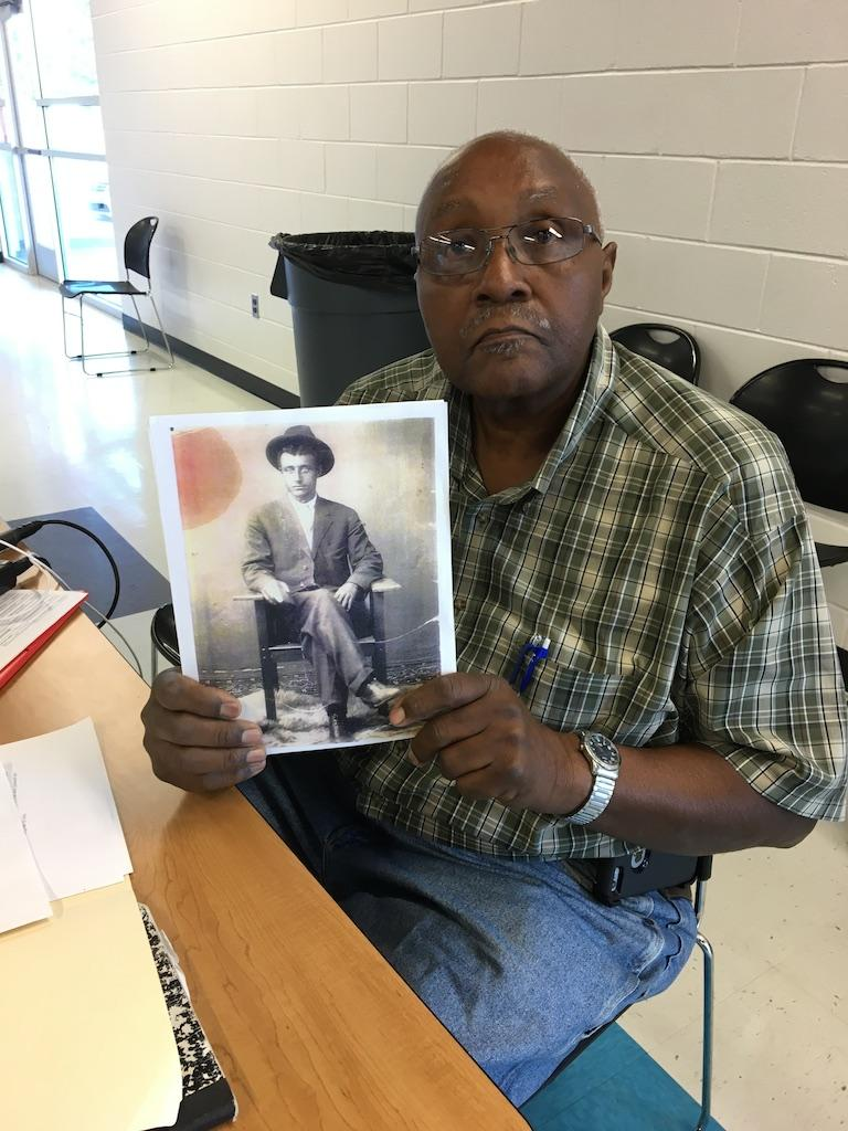 Raymond Foreman holds a picture of Zack Foreman, his great uncle, who was on the Cherokee Freemen Rolls