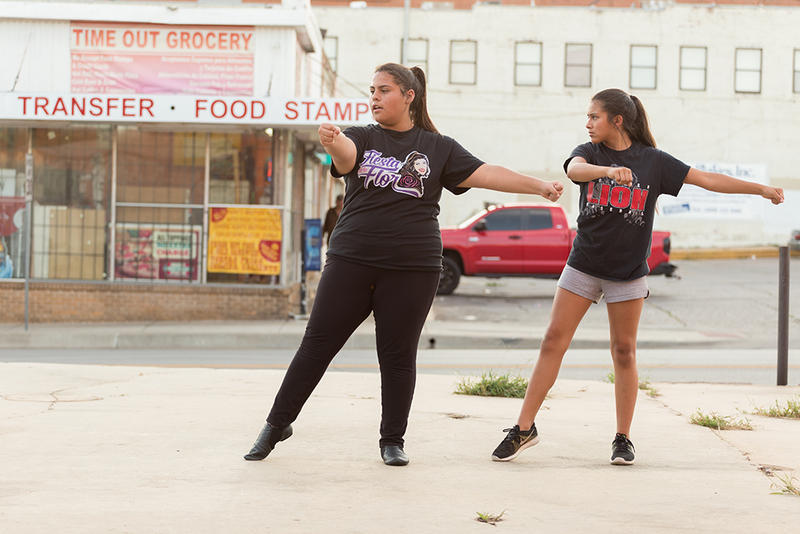 Two dancers practice in an empty lot next to their International Dance Studio (IDance) in Capitol Hill.