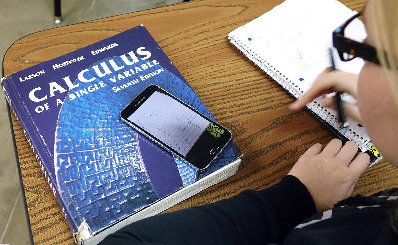 Senior Alexa Ostmeyer, 18, does schoolwork during an AP calculus class at Cushing High School.
