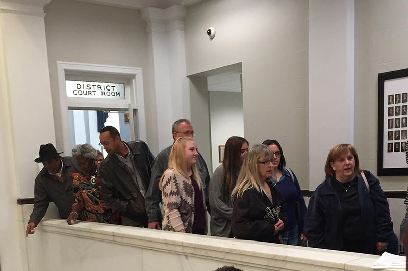 Spectators file out of the Payne County District Court Room during recess during the trial of Avery Chambers.