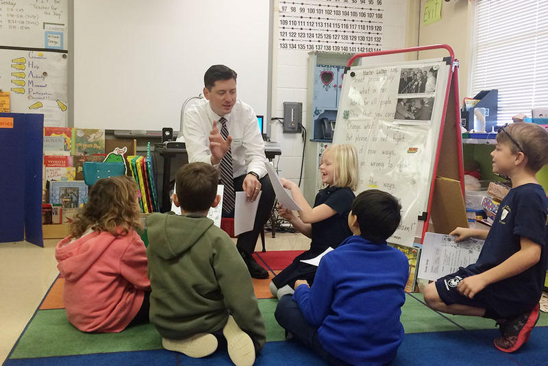 Sen. David Holt (R-Oklahoma City) reads to first grade students at Quail Creek Elementary School on Tuesday.