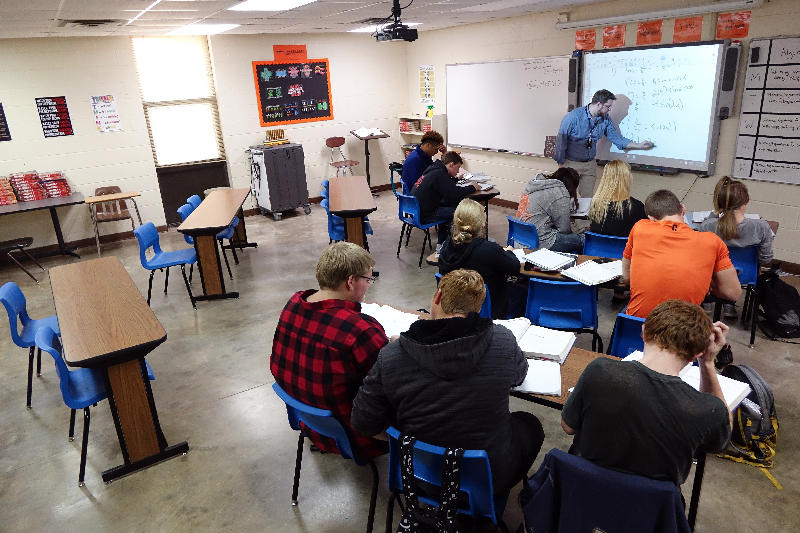 Jimmy Hartford teaches an AP calculus class to 10 students at Cushing High School on Dec. 1.