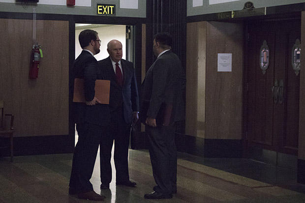 Center for Media and Democracy attorney Robert Nelon, center, outside a courtroom in Oklahoma City.