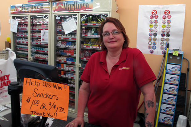 Geary, Oklahoma, Family Dollar manager Jacquie Hogue running the register in her store.