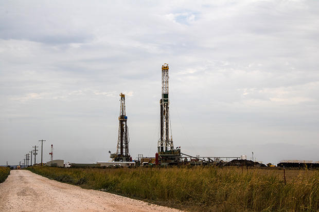 A pair of drilling rigs in Kingfisher County, Okla.