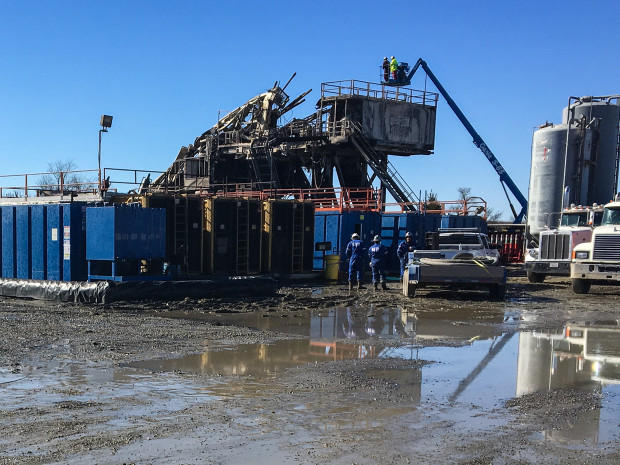 Inspectors and emergency crews surveying damage at Patterson-UTI's rig 219, which exploded and caught fire Jan. 22.