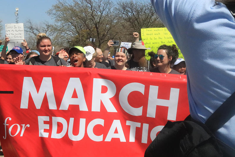 Educators arrive at the state Capitol on Tuesday, April 10, 2018, completing a seven day, 110 mile walk from Tulsa to Oklahoma City in support of increased education funding.