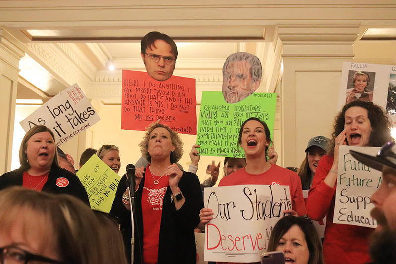 Oklahoma Education Association leaders Alicia Priest (left) and Katherine Bishop (second from left) lead chants in the Capitol rotunda.