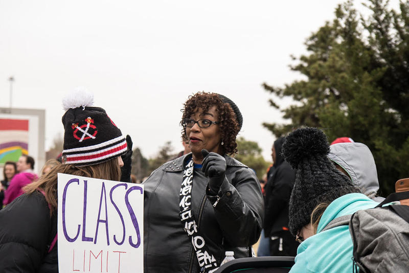 Debra Davis, a teacher from Northwest Classen High School in Oklahoma City, talks with teachers and students during Monday's walkout.