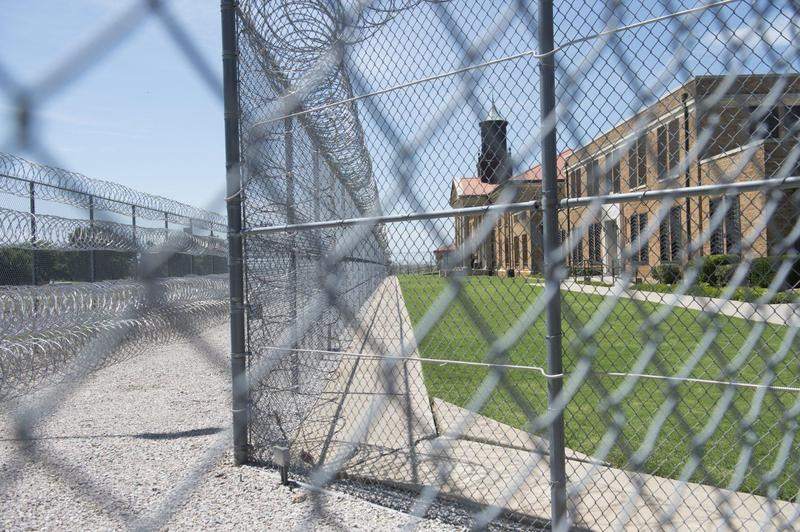 Fences and barbed wire at the entrance of the El Reno Federal Correctional Institution in El Reno, Okla., July 16, 2015.