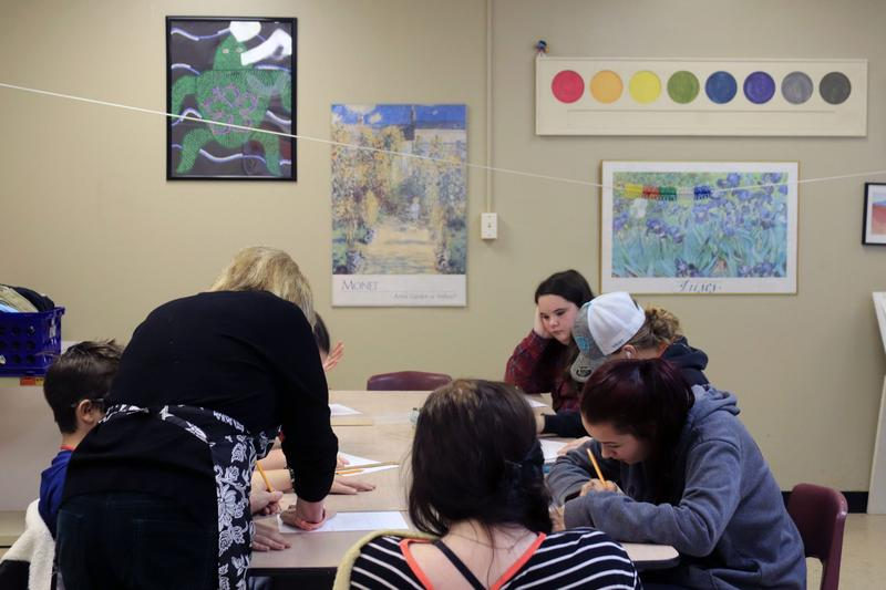 Librarian Brenda Roberts works on an art project with a group of eighth graders in Wanette Public Schools.