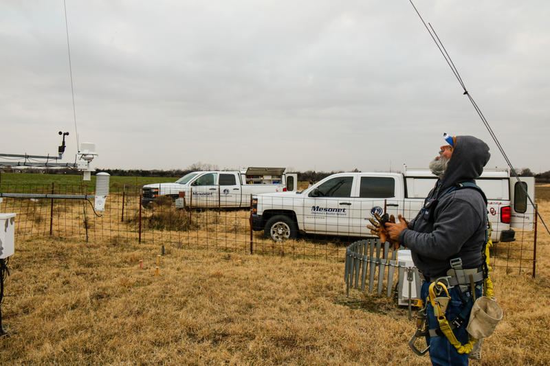 Meteorological Electronics Technician Kirk Wilson eyes the top of a 30-foot tower as he prepares to replace a wind sensor at an Oklahoma Mesonet station near Shawnee, Okla.