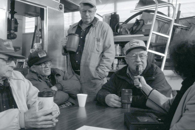 Phyllis Silver interviews members of the Latah Men's Coffee Club during Take the Old Road's visit to the town of Latah in Spokane County, Washington.