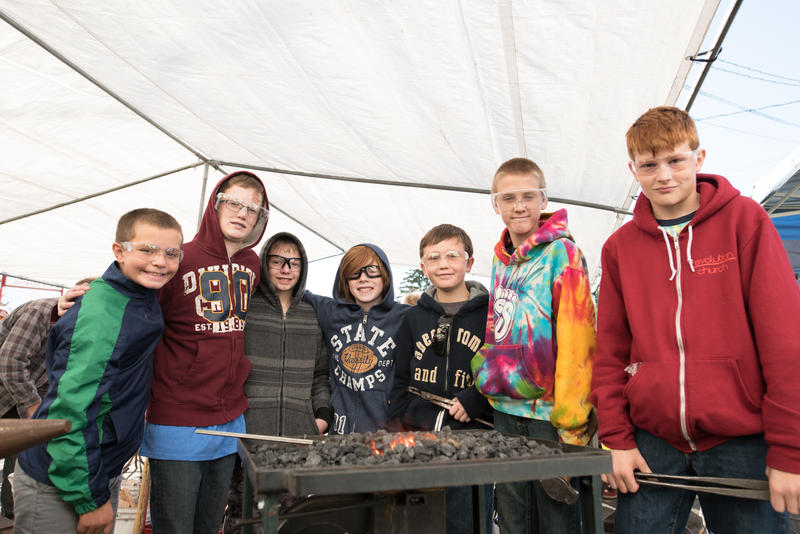"Young blacksmiths participate in one of Columbia Fire & Iron's ""Hammer-In"" events"