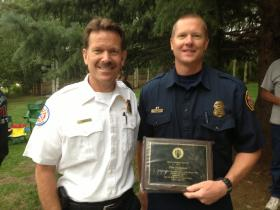 PCFD Chief Paul Hewitt, left, with Zane Thompson, recognized for exemplary work within the fire department.