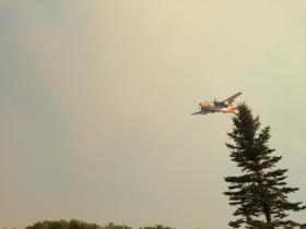 Air support dumped fire suppressant over burning areas yesterday.