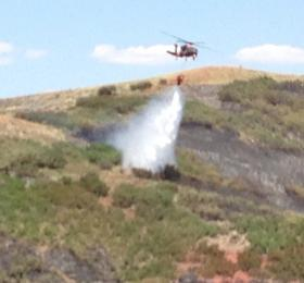 Helicopters scooped water from the nearby Rockport Reservoir to help contain the Rockport Fire.