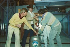 Mayor Hal Taylor,, waering the cowboy hat, in a 1986 photo tapping one of the first kegs of Wasatch Brewery beer.