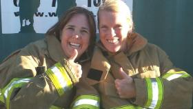 Emily Elliott and Julie Booth walked a mile in the boots of PCFD firefighters.