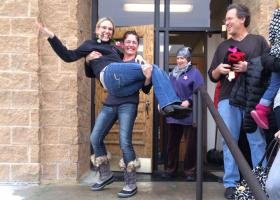 Patrice Martin carries her new bride Jamie Grunstrom out the Summit County Courthouse Monday.